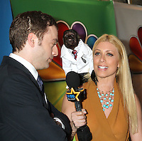 Crystal the Monkey jumps on the shoulder of a reporter at NBC's Upfront Presentation at Radio City Music Hall on May 14, 2012 in New York City. © RW/MediaPunch Inc.
