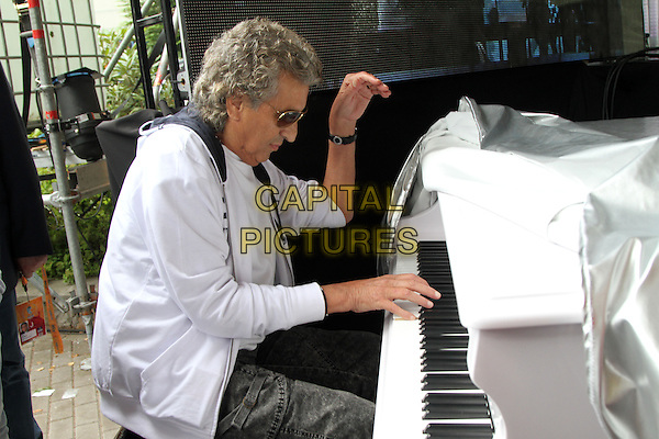 Toto Cutugno <br /> &quot;New Wave International festival&quot;, Jurmala, Latvia, 24th July 2013.<br /> half length sunglasses side playing piano music  white hoodie <br /> CAP/PER/UG<br /> &copy;UG/PersonaStars/CapitalPictures