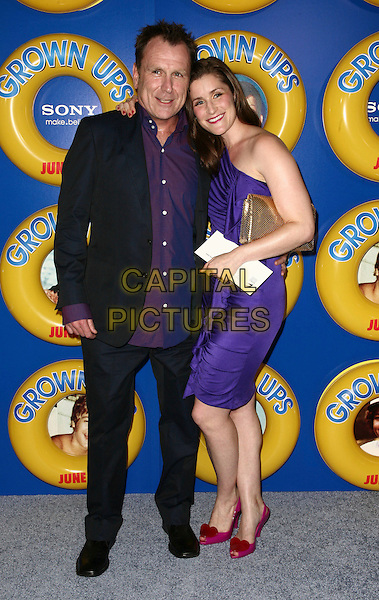 COLIN QUINN & guest .The screening of 'Grown Ups' at the Ziegfeld Theatre in New York City, NY, USA, 23rd June 2010..arrivals full length black jacket purple one shoulder dress shirt .CAP/ADM/PZ.©Paul Zimmerman/AdMedia/Capital Pictures.