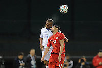 Washington, D.C.- May 29, 2014. Honduras defender Victor Bernadez Blanco heads the ball against Turkey forward Mustafa Pektemek. Turkey defeated Honduras 2-0 during an international friendly game at RFK Stadium.