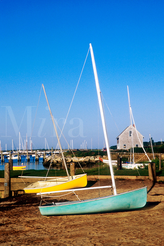 Small sailboats on the shore of Chatham Harbor. Cape Cod.