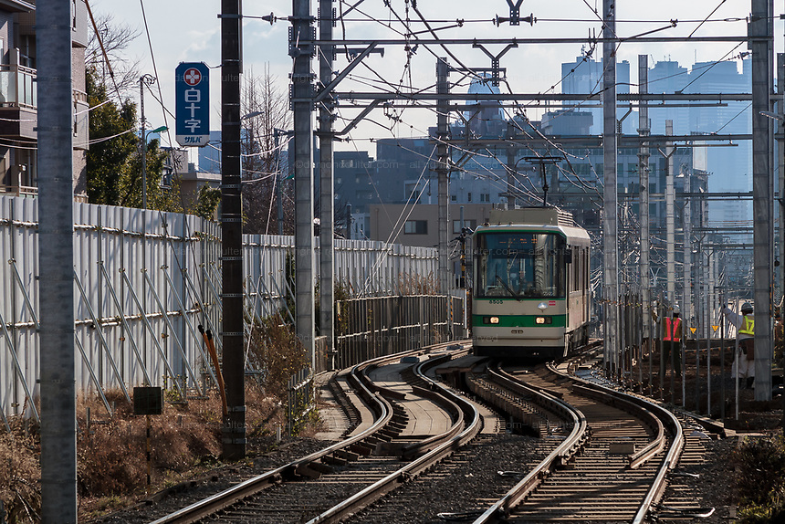 Trams on the Toden Arakawa Line. Zoshigaya, Tokyo, Japan. Friday January 15th 2016