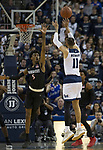 Nevada forward Cody Martin (11) shoots over San Diego State forward Jalen McDaniels (5) in the first half of an NCAA college basketball game in Reno, Nev., Saturday, March 9, 2019. (AP Photo/Tom R. Smedes)