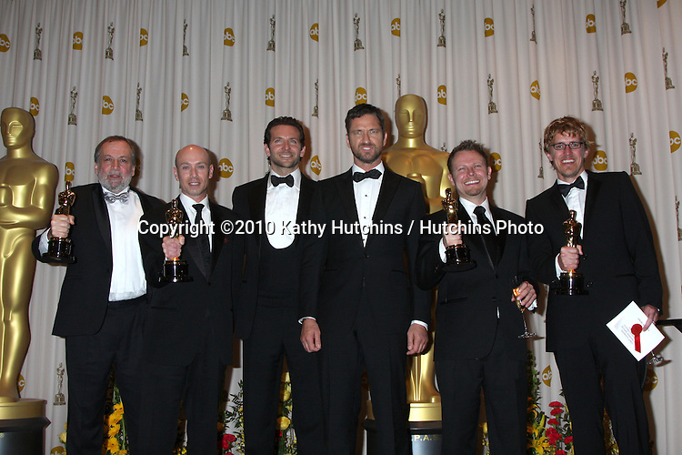 Presenters Bradley Cooper and Gerard Butler (both center) pose with (L-R) Joe Letteri, Stephen Rosenbaum, Richard Baneham and Andrew Jones, winners of Best Visual Effects for 'Avatar.in the Press Room of the 82nd Academy Awards.Kodak Theater.Los Angeles, CA.March 7, 2010.©2010 Kathy Hutchins / Hutchins Photo....