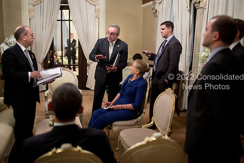 United States President Barack Obama prepares for a press conference at the Government House in Bangkok, Thailand, November 18, 2012. Pictured, from left, are: Danny Russel, Senior Director for Asian Affairs; Kurt Campbell, Assistant Secretary of State for East Asian and Pacific Affairs; Secretary of State Hillary Rodham Clinton: Director of Communications Dan Pfeiffer; and Ben Rhodes, Deputy National Security Advisor for Strategic Communications.  .Mandatory Credit: Pete Souza - White House via CNP
