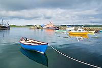 small brightly colored motorboat in Lerwick harbor, Shetland, Scotland
