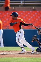 Frederick Keys designated hitter Wilson Garcia (50) follows through on a swing during the first game of a doubleheader against the Lynchburg Hillcats on June 12, 2018 at Nymeo Field at Harry Grove Stadium in Frederick, Maryland.  Frederick defeated Lynchburg 2-1.  (Mike Janes/Four Seam Images)