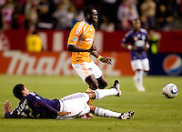 CD Chivas USA Dario Delgado (12) attempts a tackle on Houston Dynamo forward Dominic Oduro (23). The Houston Dynamo defeated CD Chivas USA 2-0 at Home Depot Center stadium in Carson, California on Saturday May 8, 2010.  .