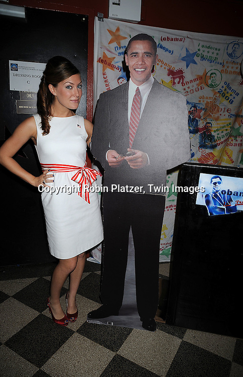 "BethAnn Bonner and cutout of Barack Obama..at The ""Spare Some Change:NYC Artists for Barack Obama""  fundraiser on August 11, 2008 at The Fifth Floor Theatre at New York University. ....Robin Platzer, Twin Images"