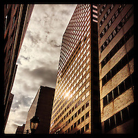 A tiny bit of sun reflects off a building on 18th Street in Center City Philadelphia on a mostly cloudy day, January 17, 2013.