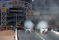 Apr 9, 2006; Las Vegas, NV, USA; A pair of Top Fuel dragsters smoke the tires during the first round of eliminations at the NHRA Summitracing.com Nationals at Las Vegas Motor Speedway in Las Vegas, NV. Mandatory Credit: Mark J. Rebilas