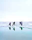 USA, Alaska, Barrow, landscape of kids playing on an ice floe in Point Barrow, near the North Pole