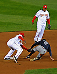 30 March 2008: Washington Nationals' infielder Cristian Guzman gets Atlanta Braves infielder Kelly Johnson out at Nationals Park where the Washington Nationals defeated the visiting Atlanta Braves 3-2 in Washington, DC. The win for the Nationals christened the new state-of-the-art ballpark with a sellout crowd of 39,389...Mandatory Photo Credit: Ed Wolfstein Photo