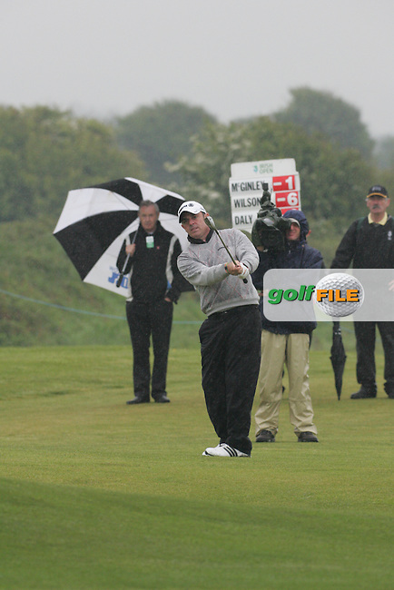 Day one from the 3 Irish open in Co Louth Golf Club..Paul McGinley playing his third shot onto the 18th green..Photo: Fran Caffrey/www.golffile.ie..