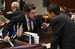 Nevada Sens. Michael Roberson, R-Las Vegas, left, and Mark Manendo, D-Las Vegas, talk on the Senate floor at the Legislative Building, in Carson City, Nev., on Monday, April 29, 2013. .Photo by Cathleen Allison
