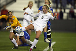 02 December 2011: Wake Forest's Riley Ridgik (2) clears the ball from Duke's Kaitlyn Kerr (in blue). The Duke University Blue Devils defeated the Wake Forest University Demon Deacons 4-1 at KSU Soccer Stadium in Kennesaw, Georgia in an NCAA Division I Women's Soccer College Cup semifinal game.