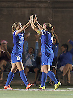 Boston Breakers midfielder Kristie Mewis (19) celebrates her goal with teammates. Allston, Massachusetts - August 17, 2014:  In a National Women's Soccer League (NWSL) match, Boston Breakers (blue) defeated Houston Dash (orange/white), 1-0, at Harvard Stadium.