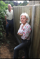 BNPS.co.uk (01202 558833)<br /> Pic: Laura Jones/BNPS<br /> <br /> A parish council that blocked a couple's garden gate in a petty row have removed the barricade after a three year battle that has cost the taxpayer &pound;14,000.<br /> <br /> Village hall officials erected a 6ft tall fence across the garden entrance that Michael and Lesley Pearse had used for 19 years to access a public park 15ft away.<br /> <br /> The bureaucrats tried to argue an easement - right of passage - the Pearses had enjoyed was a gift by them which they could withdraw.<br /> <br /> The furious couple insisted the right of way was written into their deeds and asked Queen Thorne Parish Council in Dorset to remove their fence.<br /> <br /> The officials refused, resulting in a legal dispute that lasted for nearly three years until the case was settled in favour of the Pearses on the eve of the matter going to court.