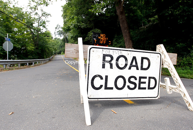 Southbury, CT-01 August 2012-080112CM01-  A portion of River Road in Southbury is closed to through traffic as public works crews replace a bridge over the Little Pootatuck River in Southbury.  The work is expected to take all week after officials deemed the bridge unsafe.  Christopher Massa Republican-American