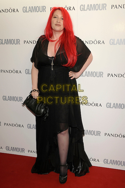 Jane Goldman .Glamour Women Of The Year Awards held at Berkeley Square Gardens, London, England..June 7th 2011..inside arrivals full length black sheer long maxi dress hand on hip bag .CAP/PL.©Phil Loftus/Capital Pictures.