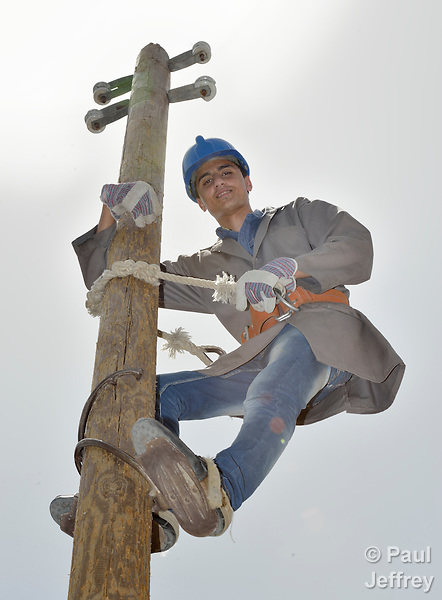 Student Aeed Ghonaim climbs a utility pole during a class on electrical wiring at the Vocational Training Center in Khan Yunis, Gaza. The center is sponsored by the Department of Service for Palestinian Refugees of the Near East Council of Churches, and funded in part by the Pontifical Mission for Palestine. DSPR is a member of the ACT Alliance.