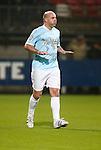 Nederland, Almelo, 22 december 2012.Andy van der Meyde (Meijde) in actie in een shirt van Radio 3FM. De opbrengst van de wedstrijd komt ten goede aan de actie Radio 3FM Serious Request 'Let's hear it for the babies'