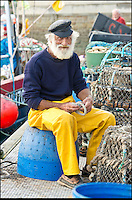 BNPS.co.uk (01202 558833)<br /> Pic: RachelAdams/BNPS<br /> <br /> Ivor Charles mends lobster pots at Weymouth Quay.<br /> <br /> Lights, camera, plankton!<br /> <br /> A crew of fishermen are enjoying unlikely sideline careers as actors in blockbuster films - thanks to their salty sea dog looks.<br /> <br /> The gang's craggy features, big beards and wild hair have helped them bag roles alongside Hollywood A-listers such as Johnny Depp and Charlize Theron.<br /> <br /> As many as 12 weather-beaten fishermen from Weymouth, Dorset, have found success on the big screen since signing up with a casting agency.<br /> <br /> And thanks to their authentic appearances they are regularly snapped by film producers wanting to make nautical scenes more realistic.