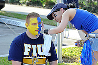 1 October 2011:  A fan has his face painted FIU's school colors--gold and blue--prior to the game.  The Duke University Blue Devils defeated the FIU Golden Panthers, 31-27, at FIU Stadium in Miami, Florida.
