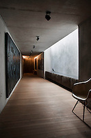 A long concrete corridor in the basement leads up to the other floors.  The painting is by Ahmet Oran