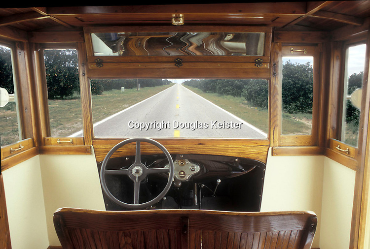 While not exactly designed for comfort, the front seat accommodates two cozy campers. Everything is original, including the honey-toned oak trim and what appears to be the world's largest rearview mirror.