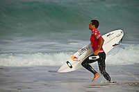 Adriano de Souza (BRA).  CULS NUS BEACH, Hossegor/France (Monday, September 27, 2010) -The pumping barrels of yesterday gave way to inconsistent two-to-three foot (1 metre) waves this morning, prompting event organizers at the Quiksilver Pro France to call competition off after completing the opening three heats of Round 2.. .The seventh stop on the 2010 ASP World Tour, the Quiksilver Pro France was forced to halt competition early today, but the world's best surfers still provided fireworks amidst the challenging conditions.. .Julian Wilson (AUS), 21, wildcard into the Quiksilver Pro France, caused a major upset this morning, defeating current ASP World No. 6, Bede Durbidge (AUS), 27, with a strong backhand wave at the end of the heat.Kelly Slater (USA), 38, former nine-time ASP World Champion and current ASP World No. 1, survived a wave-starved Round 2 bout today against wildcard Maxime Huscenot (FRA), 18, in the opening heat of the day..Gabe Kling (USA), 30, wildcard for the back half of the 2010 ASP World Tour season, scored the day's second and final major upset, ousting current ASP World No. 7, Adriano de Souza (BRA), 23, from Quiksilver Pro France competition.. Photo: joliphotos.com