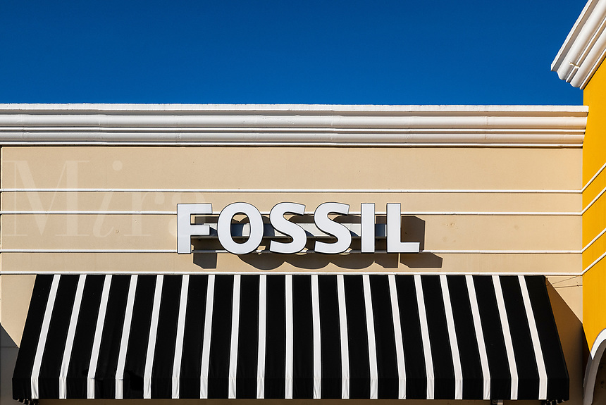 Fossil watch store and sign.