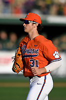 Center fielder Bryce Teodosio (31) of the Clemson Tigers runs in from the field in a game against the William and Mary Tribe on February 16, 2018, at Doug Kingsmore Stadium in Clemson, South Carolina. Clemson won, 5-4 in 10 innings. (Tom Priddy/Four Seam Images)