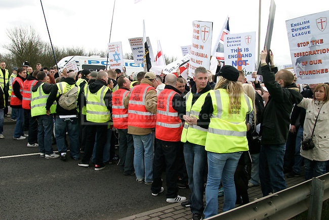 EDL stewards hold back the main body of protesters as they attempt to keep the march under control.