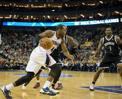 16.01.2014 London, England.  Atlanta Hawks' Forward Paul Millsap [4] drives for the basket during the NBA regular season game between the Atlanta Hawks and the Brooklyn Nets from the O2 Arena.
