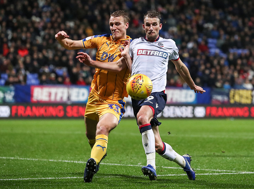Bolton Wanderers' Christian Doidge competing with Wigan Athletic's Dan Burn<br /> <br /> Photographer Andrew Kearns/CameraSport<br /> <br /> The EFL Sky Bet Championship - Bolton Wanderers v Wigan Athletic - Saturday 1st December 2018 - University of Bolton Stadium - Bolton<br /> <br /> World Copyright © 2018 CameraSport. All rights reserved. 43 Linden Ave. Countesthorpe. Leicester. England. LE8 5PG - Tel: +44 (0) 116 277 4147 - admin@camerasport.com - www.camerasport.com
