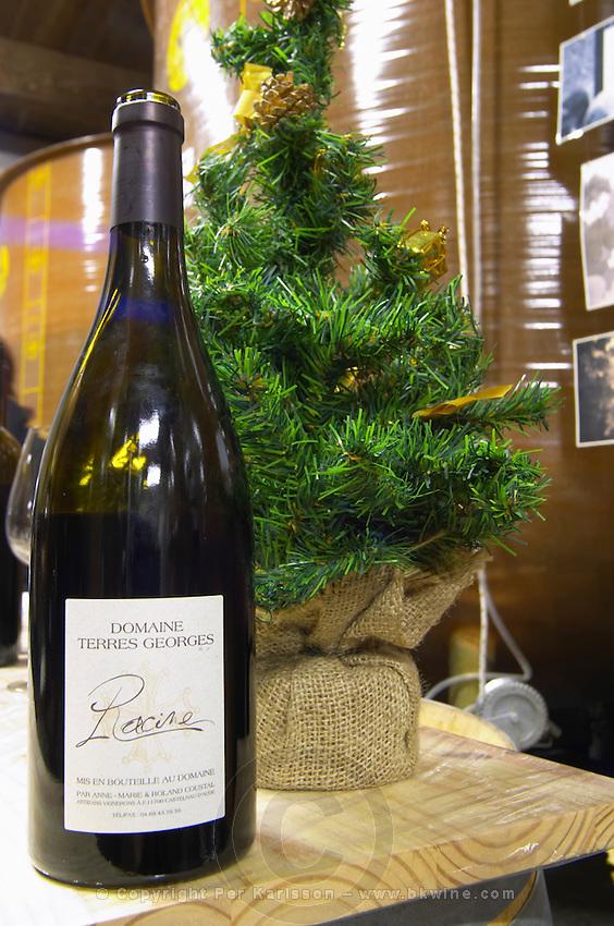 Cuvee Racine and a Christmas tree. Domaine Terres Georges. In Castelnau d'Aude. Minervois. Languedoc. Fibreglass vats. France. Europe. Bottle.
