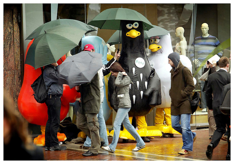 Fair Weathered Birds....Character's from the Lyons Tea commercials pictured sheltering from the April showers on Grafton Street, Dublin. Pic. Robbie Reynolds.