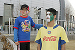 7 February 2007: Unidentified youngster wears the colors of both USA and Mexico on his face, while his Dad wears only the red, white, and green of Mexico. The United States National Team defeated Mexico 2-0 at University of Phoenix Stadium in Glendale, Arizona in an International Friendly soccer match.