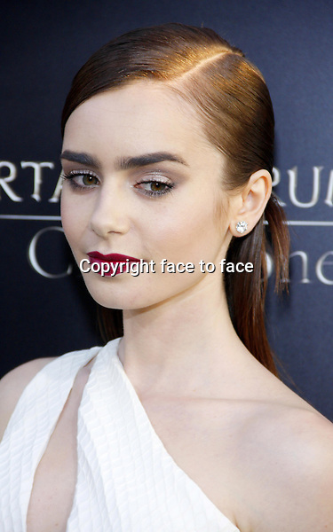 Lily Collins at the Los Angeles premiere of &quot;The Mortal Instruments: City Of Bones&quot; held at the Cinerama Dome in Hollywood in Los Angeles, California, 12.08.2013.<br /> Credit: PopularImages/face to face
