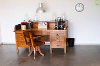An old fashioned desk and chair in wood at the entrance. Henrque HM Uva, Herdade da Mingorra, Alentejo, Portugal