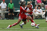 USWNT's Amy Rodriguez (8), rt and Canada's Candace Chapman battle for the ball. The U.S. Women's National Team defeated Canada 1-0 in a friendly match at Marina Auto Stadium in Rochester, NY on July 19, 2009. Abby Wambach of the USWNT scored her 100th career goal in the second half..