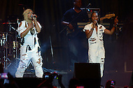 "Largo, MD - July 12, 2014: Rozonda ""Chilli"" Thomas (r)and Tionne ""T-Boz"" Watkins, of the Grammy award winning group TLC, performs at the 1st annual International Festival at the Largo Town Center in Largo, MD, July 12, 2014. The group is known for its hit songs ""Creep"" and ""Scrubs."" (Photo by Don Baxter/Media Images International)"