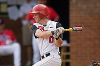 Matt Wessinger #0 of the St. John's Red Storm follows through on his swing against the Ole Miss Rebels at the Charlottesville Regional of the 2010 College World Series at Davenport Field on June 6, 2010, in Charlottesville, Virginia.  The Red Storm defeated the Rebels 20-16.  Photo by Brian Westerholt / Four Seam Images
