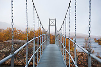Hanging footbridge over river to Abiskojaure hut, Kungsleden trail, Lapland, Sweden