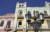 Colonial edifices in pink and yellow pastels, an old fashioned street lamp circa 1808, and historical building details Havana, Cuba