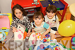 PLAY TIME: Taking part in the Meningitis Trust Coffee Morning and Fun Day at the Duagh family Resource Centre on Friday last were Ellie O'Connor and sisters Aoife and Mary Bates.