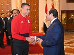 Egyptian President Abdel Fattah al-Sisi meets with Egypt's national football team before travelling to Russia to attend World Cup at the Ittihadiya presidential palace in Cairo, Egypt, June 9, 2018. Photo by Egyptian President Office