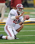 Alabama Crimson Tide quarterback AJ McCarron (10) warms up with kickers before the game. The Alabama Crimson Tide defeated the Missouri Tigers 42-10 at Memorial Stadium in Columbia, Missouri on October 13, 2012.