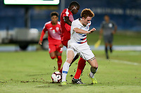GEORGETOWN, GRAND CAYMAN, CAYMAN ISLANDS - NOVEMBER 19: Josh Sargent #19 of the United States battles for a ball during a game between Cuba and USMNT at Truman Bodden Sports Complex on November 19, 2019 in Georgetown, Grand Cayman.